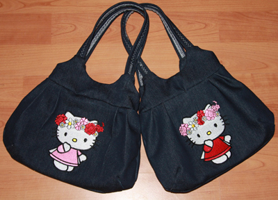 Two bags with hello kitty machine embroidery design